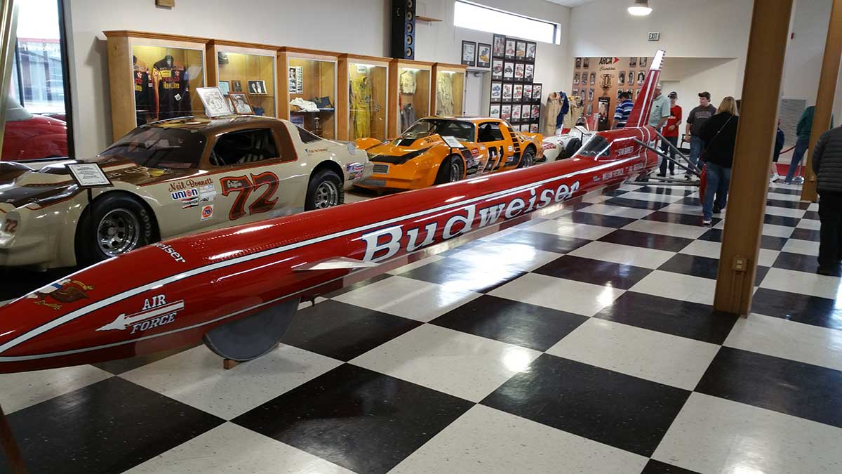 GERRY-WITH-THE-BUDWISER-ROCKET-CAR-AT-THE-MOTORSPORTS-HALL-OF-FAME-08-17-(2)